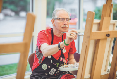 Older adult painting at Myerberg