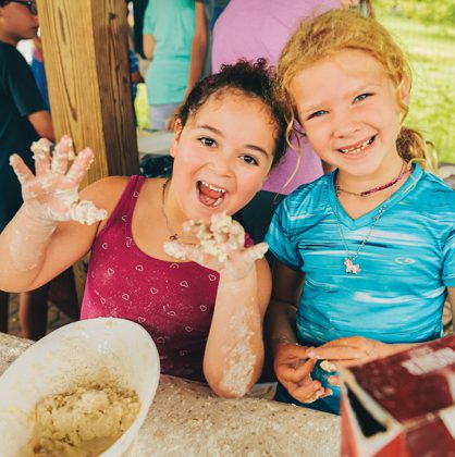 Two young girls at Family Camp Day at Pearlstone