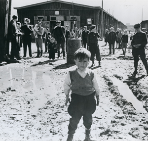 Displaced Persons camp in Salzburg, Austria, with unidentified young boy in the foreground