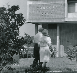 Couple walking in front of the Concord House